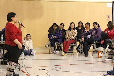 Quaqtaq's then mayor Eva Deer speaks to women at the 2013 Arnaliat Nipingit conference in her home community. (PHOTO COURTESY OF SATURVIIT)