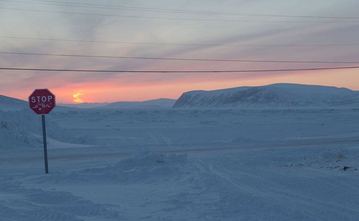 It's that time of year when Nunavummiut above the Arctic Circle start pining for the return of the sun. Persistent clouds in northeast Baffin have prevented residents of Clyde River from knowing, for certain, whether the sun has peeked over the horizon yet. This scene was captured around noon on Jan. 17. (PHOTO BY NIORE IQALUKJUAK)