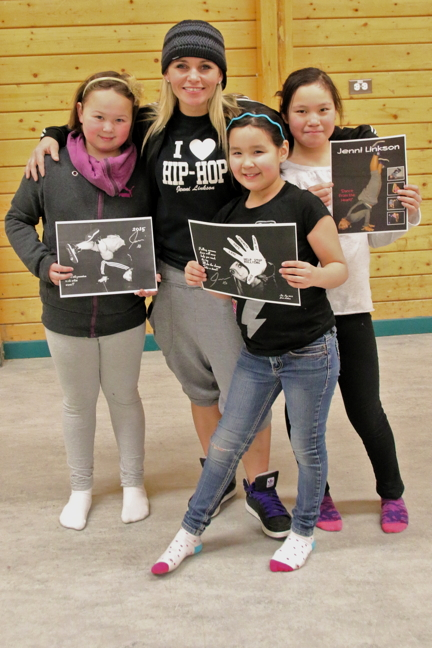 A trio of Cambridge Bay dancers pose with their favourite hip hop instructor, Jenni Linkson. The Niagara-based dance instructor takes time out every year to come north and teach Nunavut kids how to bust a move. From left, Averi Kaiyogana, Jenni Linkson, Aaliyah Epilon and Reagan Evetalegak. (PHOTO BY KELCEY WRIGHT)