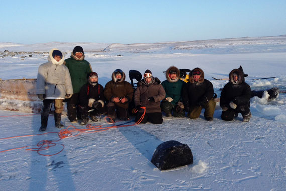 Charlie Pinguartuk, second from left, returned Jan. 10 to the same lake where his skidoo has gone through the ice the night before. After he was rescued by Charlie Ikey, second from right, this group of hunters returned to the site to retrieve Pinguartuk's skidoo the following day. (PHOTO COURTESY OF C. IKEY)