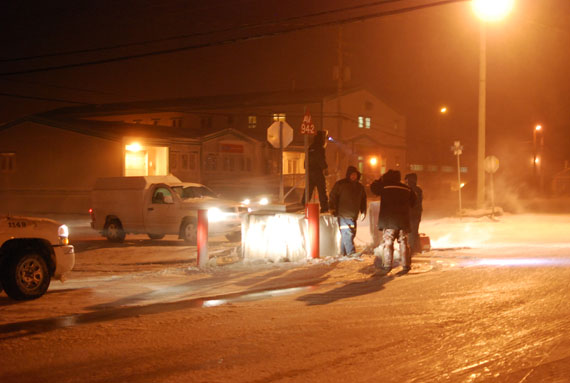 Contractors and Community and Government Services workers tend to a water main break in Rankin Inlet Jan. 31, which caused a water leak at a busy intersection. The Kivalliq community remains under an extreme cold warning Feb. 2, with blizzard conditions developing later in the day. (PHOTO BY NOEL KALUDJAK)