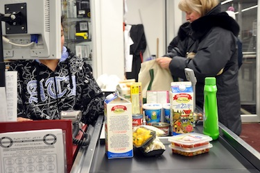 A shopper stocks up on groceries at Newviq'vi in Kuujjuaq, one of more than 100 communities that benefits for food subsidies under Nutrition North Canada. (FILE PHOTO)