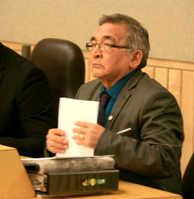Alexander Sammurtok, MLA for Rankin Inlet South, in Nunavut's legislative assembly March 2, lines up to submit a petition from his constituents in favour of a 24-hour elders' care facility in Rankin Inlet. (PHOTO BY PETER VARGA)