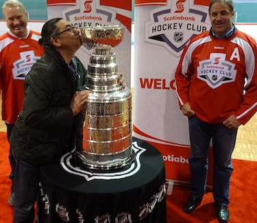 Romeo Saganash, MP for Abitibi-James Bay-Nunavik-Eeyou, in Kuujjuaq to speak with delegates at the Makivik Corp.'s annual general meeting, greets the Stanley Cup which displayed in the Kuujjuaq Forum. (PHOTO BY JANE GEORGE)