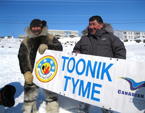 Solomon Awa, left, celebrates with the winner of the Toonik Tyme festival's igloo-building contest in 2014, Paul Irngaut. Awa will direct many of the Iqaluit festival's traditional Inuit activities for this year's 50th anniversary. (PHOTO BY PETER VARGA)
