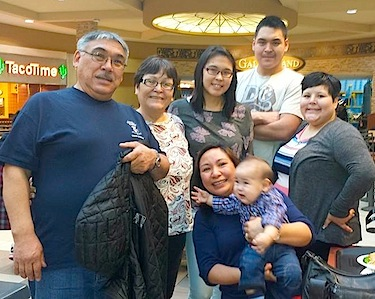 Stanley Anablak, far left, the Kitikmeot Inuit Association's new president, stands with members of his family in this photo posted on his Facebook page.