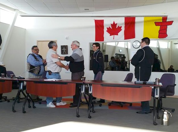 Representatives of the Kitikmeot Inuit Association and TMAC Resources Inc. shake hands March 30 at the KIA's head office in Cambridge Bay after signing a comprehensive land agreement to provide access to the Hope Bay region for long-term mineral development as well as an Inuit Impact and Benefit Agreement on contracts, jobs and training. This signing ceremony topped off more than a year of work between the KIA and TMAC, which wants to bring Hope Bay's Doris North gold mine project out of care and maintenance in 2015. From left to right: Paul Emingak, KIA's executive director, Charlie Evalik, interim KIA President, Gord Morrison, TMAC's president, Catharine Farrow, TMAC's chief executive officer, and Alex Buchan, TMAC's director of Community Relations.