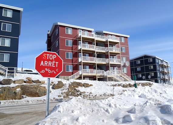 A stop sign stands near the Road to Nowhere neighbourhood in Iqaluit where many residents live in apartments and condos. An Iqaluit woman has started a petition to ban smoking indoors in multi-dwelling buildings such as these. (PHOTO BY JANE GEORGE)