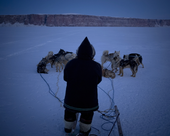 Peugatuk Ettuk, an Arctic Bay elder and dog musher, took photographer Acacia Johnson to an outpost camp several hours outside of Arctic Bay for a night out on the land in late January 2015. He has since passed away. (PHOTO BY ACACIA JOHNSON)