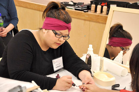 Arviat tenth grader Destiny St. John concentrates as she competes in the aesthetic competition at the territorial skills competition at Inuksuk High School in Iqaluit April 28. (PHOTO BY THOMAS ROHNER)