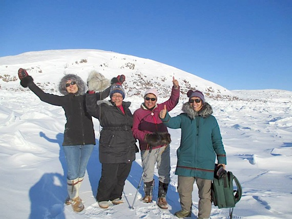 Half of this year's Women in Action group, from left, Madeleine Cole, Joanna Awa, Edna Elias and Mary Wilman, are pictured here during a training exercise in February. A group of eight women will set off from Hall Beach May 2, with hopes of reaching Igloolik by foot in three days. (PHOTO COURTESY OF JOANNA AWA)