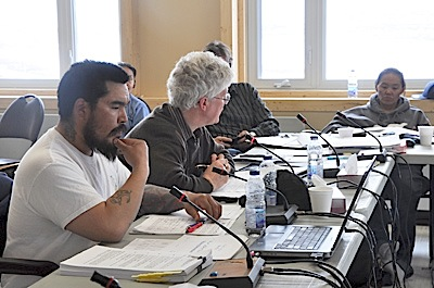Daniel Oovaut, left, chair of the KHMB, and Watson Fournier, its executive director, field questions from KRG councillors at a regional council meeting in Inukjuak May 26. (PHOTO BY SARAH ROGERS)