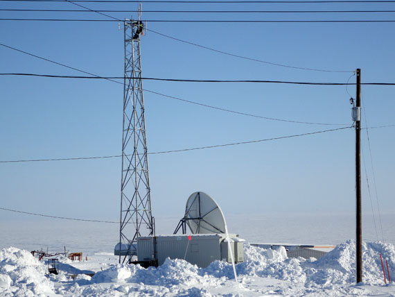 An SSI Micro communications site in Nunavut, showing a satellite dish and wireless antenna. The company has teamed up with the Kitikmeot Inuit Association to start a pilot project in Kugluktuk and Cambridge Bay that will offer Inuit-language programming on FM radio. (PHOTO COURTESY OF SSI MICRO)