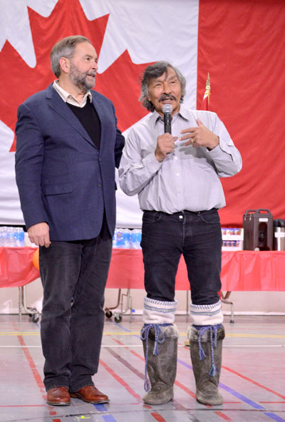 "NDP leader Thomas Mulcair with Nunavut candidate Jack Anawak at a community feast held Sept. 29 in Iqaluit. ""You deserve to have someone as dedicated and hardworking as Jack Anawak work for you and we will do everything to get him elected,"
