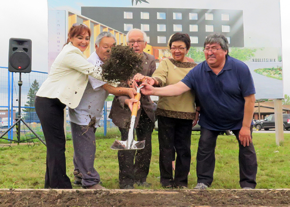 With shovel in hand, Nunavik health officials break ground Sept. 29 at the site of the region's new Montreal patient transit centre; from left, Northern Quebec Module director Maggie Putulik, Ivujivik patient Mattiusi Iyaituk, Dorval mayor Edgar Rouleau, Nunavik Regional Board of Health and Social Services chair Elisapi Uittangak and Innuulitsivik health care centre chair Aliva Tulugak. Construction will begin this fall on the 143-bed facility, which is expected to open in December 2016. (PHOTO BY BOB MESHER)
