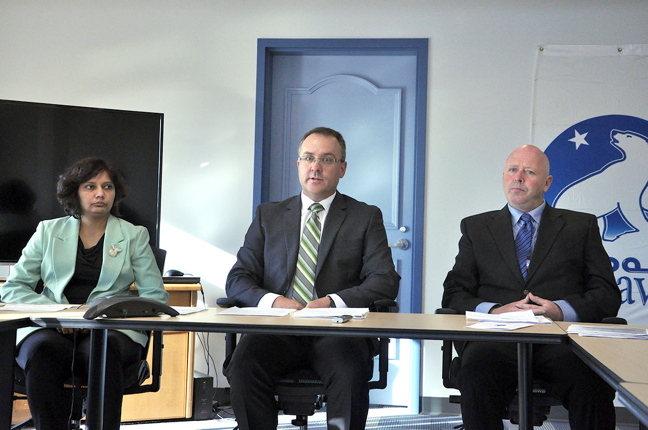 Nunavut's chief coroner, Padma Suramala (far left), her legal counsel, Sheldon Toner, and Northwest Territories coroner Garth Eggenberger at a news conference in Iqaluit Sept. 10, before the start of an inquest into Nunavut's high suicide rates which began Sept. 14 and wrapped up Sept. 24. (PHOTO BY THOMAS ROHNER)