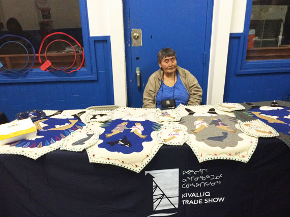 Rankin Inlet artist Veronica Manilak watches over her wares at the Kivalliq Trade Show, which is being held in Rankin Inlet this week. Manilak, who is well-known for her hand-made wall hangings cut in the shape of drying seal skin, is one of many artisans selling their work at the three-day event, which wraps up Sept. 30. (PHOTO BY NOEL KALUDJAK)