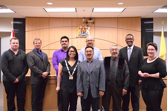 Iqaluit's new mayor and city councillors may now begin their three-year terms of office after being sworn in at the Nunavut Court of Justice building in Iqaluit Nov. 2. From left: Jason Rochon, Terry Dobbin, Gideonie Joamie, Mayor Madeleine Redfern, Romeyn Stevenson (back), Joanasie Akumalik (front), Simon Nattaq, Kuthula Matshazi and Megan Pizzo-Lyall. Redfern won 59 per cent of votes cast in Iqaluit's municipal election Oct. 19, beating out incumbent mayor Mary Wilman and former councillor Noah Papatsie for the city's top job. (PHOTO BY STEVE DUCHARME)