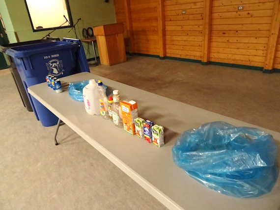 Recyclable items and the new bins are on display at the Luke Novoligak community hall in Cambridge Bay Sept. 30. (PHOTO BY JANE GEORGE)
