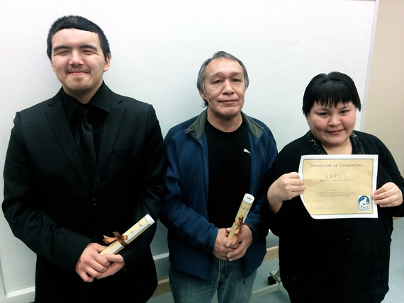 G.R.E.A.T. graduates Tedd Nattaq, Thomassie Ishulutak and Lisa Panniluk celebrate the completion of the 12-week employment skills program in Iqaluit Dec. 22. (PHOTO COURTESY OF THE GN)