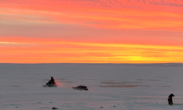 A hunter crosses the bay around 1:30 p.m. on Dec. 20, near Cambridge Bay in western Nunavut. Though the sun had basically disappeared by then, it still shone from below the horizon, setting the cloudy sky on fire in shades of yellow and orange and casting a warm glow on residents below. The Iqaluit and Ottawa offices of Nunatsiaq News will close Jan. 1 for the New Year's Day holiday. We would like to thank all our contributors, especially our talented community photographers, including Sarah Meeko, Niore Iqalukjuak, Denise Lebleu, Isabelle Dubois, Jesse Ajayi, Clare Kines, Noel Kaludjak, Derrick Anderson, Frank Reardon, Valter Botelho, David Kilabuk, Doug McLarty, Eric Anoee, Paul Aningat, Claude Constantineau and others. We'd also like to wish our readers and followers a safe and happy New Year and we hope you enjoy your long weekend. Our Jan. 1, 2016 newspaper should be available for pick up by Jan. 2 at the usual locations in your community. We'll be back to regular office hours Jan. 4. (PHOTO BY DENISE LEBLEU)