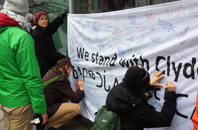 Toronto supporters of Clyde River residents, opposed to offshore seismic testing near their community, sign a banner outside the Federal Court of Appeal last year. The lawyer for those Clyde River residents now wants the Supreme Court of Canada to hear his case, and that of an Ontario First Nation, jointly, because they make similar arguments against the National Energy Board's natural resource development approval process. (FILE PHOTO)