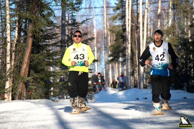 Jimmy Emudluk, left, competes in a snowshoeing race in the 2014 Arctic Winter Games in Fairbanks, Alaska. (PHOTO COURTESY KATIVIK REGIONAL GOVERNMENT)