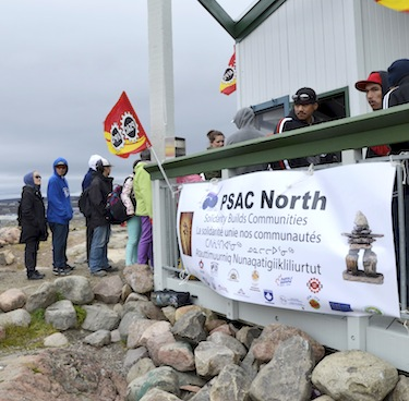 PSAC members line up for food at a 2013 Labour Day picnic at Sylvia Grinnell Park. PSAC officials will hold a rally at Iqaluit City Hall at 10:00 a.m. today to burn a letter the city sent this week to its unionized employees. Read more later. (FILE PHOTO)