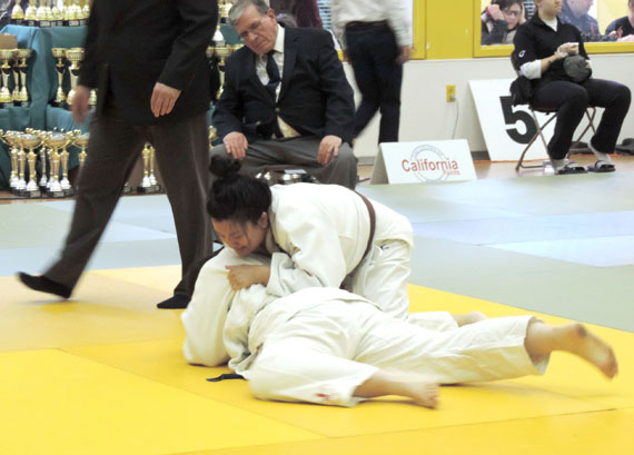 A member of Nunavut Judo competes in Montreal at the Montreal Cup Judo Tournament at the Centre Sportifs Côte-des-Neiges held March 12 and March 13. While most Nunavut residents were consumed by the Arctic Winter Games event that week, Nunavut's young judoka won eight medals and two trophies at the Montreal tournament: two bronze medals, four silver medals, two gold medals and two trophies. Read more later on Nunatsiaqonline.ca. (PHOTO COURTESY OF ANDREW KEIM)