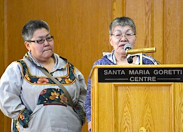 Cathy Aitaok and Louisa Baril of Cambridge Bay talk April 1 at a symposium on the Charles Camsell Hospital. Baril spoke about her father, Elulik, who went south in 1960, never returned and now lies in an unmarked grave at a Catholic cemetery in Edmonton. (PHOTO BY BRENDAN GRIEBEL/KHS)