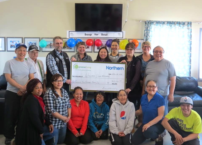 Staff at the Cambridge Bay Wellness centre in Cambridge Bay stand with employees from the local Northern store who gave the centre's soup kitchen $10,000 on April 22. The money comes from the sale of plastic bags at the store. Previous recipients of the yearly grant include the Hamlet and students at Kiilinik high school. (PHOTO COURTESY OF THE WELLNESS CENTRE)
