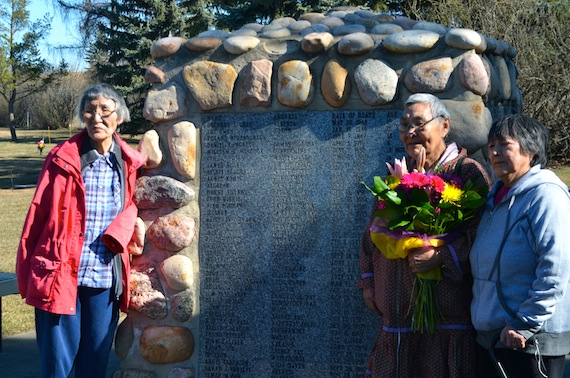 Mabel Etigik, Annie Atighioyak and Mary Avalak stand next to the cairn honouring the former patients at the Charles Camsell Hospital in Edmonton are buried at the St. Albert cemetery in unmarked graves. (PHOTO BY BRENDAN GRIEBEL)