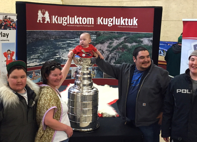 Kugluktuk Mayor Ryan Nivingalok and his wife Amy put their future Jordin Tootoo into the Stanley Cup April 28 during a Project North sponsored tour this spring in Nunavut. Famed NHL alumni Lanny McDonald and Mark Napier are joining the cup on its northern tour, shaking hands and signing autographs. Project North, with help from partners ScotiaBank, Canadian Tire, First Air and Adventure Canada, is bringing the cup to seven Nunavut communities this spring and, in Kugluktuk and Igloolik, they are donating 25 sets of new hockey equipment for kids. Project North, which launched seven years ago, has to date donated more than $700,000 worth of hockey equipment to 22 communities in Nunavut and two communities in Labrador. The cup is expected in Arctic Bay and Pond Inlet today and then it's on to Igloolik, Cambridge Bay and Yellowknife on Saturday, May 1. See more photos on our Facebook page. (PHOTOS COURTESY ADVENTURE CANADA)