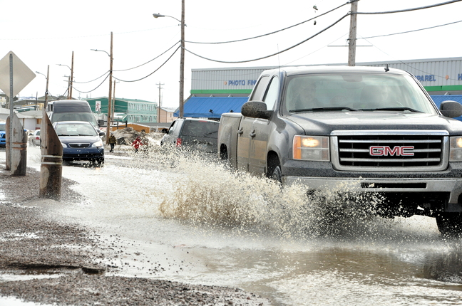 If you think driving is bad... try walking, and staying dry, in Iqaluit this week. (PHOTO BY THOMAS ROHNER)