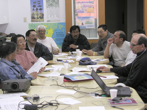From a May 2002 meeting of the Beverly and Qamanirjuaq Caribou Management Board in Baker Lake, from left to right: Baker Lake's Harold Elegoyoak, Susan Toolooktuk, Joedee Joedee (HTO vice-president), Norman Attungala, David Aksawnee (HTO president), Phillip Putumiraqtuq (HTO secretary-treasurer), Thomas Kudloo and, on the far right, Gunther Abrahamson, who served for many years as secretary to the board. (PHOTO BY GARY KOFINAS)