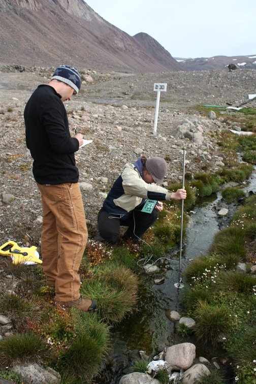 Rob Jamieson, who holds the Canada Research Chair in Cold Regions Ecological Engineering at Dalhousie University in Halifax, with team member Leah Boutilier, sampling water in Grise Fiord in 2010. (PHOTO COURTESY ROB JAMIESON)