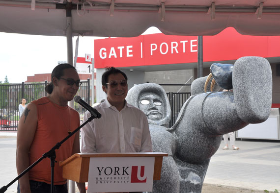 Nunavut artists Ruben Komangapik, left and Koomuatuk (Kuzy) Curley, right, talk about Ahqahizu, their 26-tonne creation during its unveiling at Toronto's York University June 21, for National Aboriginal Day. (PHOTO BY SARAH ROGERS)