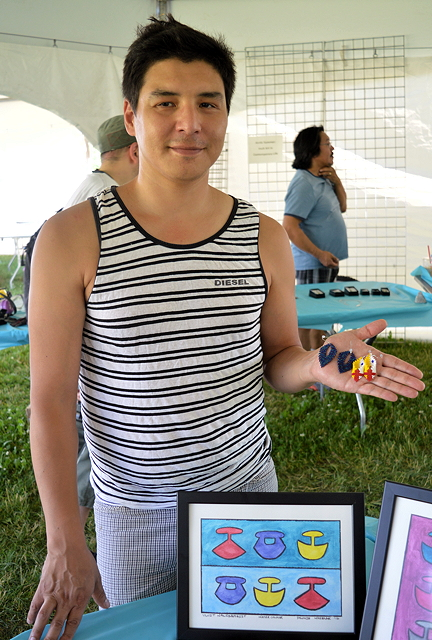 Dennis Nakoolak, 35, paints with watercolours and creates bead-work earrings as a hobby in his spare time. Originally from Iqaluit, he has been living in Ottawa for a few years now and works at the Akausivik Inuit health centre as a case manager.