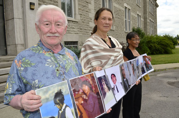 Residential school survivor Pita Irniq, human rights advocate Lieve Halsberghe and supporter Susie Utatnaaq stand before the Oblate-owned Edifice Deschâtelets at 175 Main St. in Old Ottawa East to protest the Oblate order's 200th anniversary this year. (PHOTO BY JIM BELL)