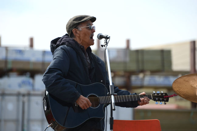 Charlie Panigoniak performs in Rankin Inlet for Nunavut Day 2015. The legendary musician and songwriter is in ailing health so fans and friends in Arviat have organized a tribute concert for him tonight, Aug. 30, at 7 p.m. at the community hall. (PHOTO BY NOEL KALUDJAK)