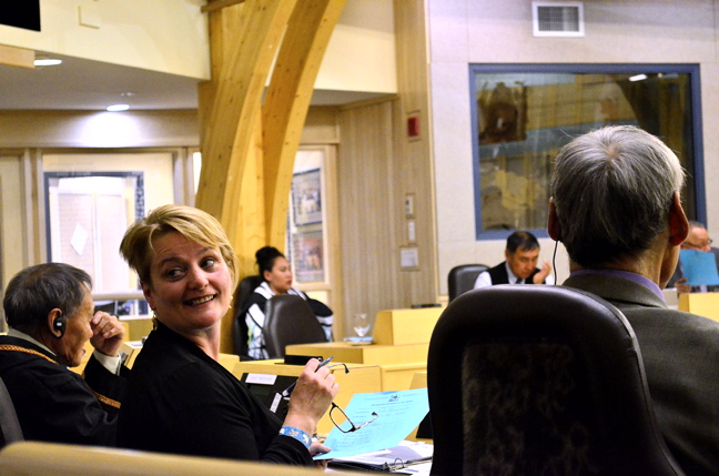 Iqaluit-Niaqunnguu MLA Pat Angnakak shares a smile with a visitor at the Nunavut Legislative Assembly last week. Angnakak has been asking cabinet members in the legislature for progress reports on a couple of bodies she wants to see established: a board of management for the Qikiqtani General Hospital and a public service commission, an independent body that manages government human resources and which MLAs voted for unanimously during the spring sitting. Now into their third week of the fall sitting, Nunavut MLAs and ministers have sparred over a range of issues from family service interventions to caribou quotas and Inuit language rights. Scroll through our main page and news page to see what you've missed. This session is expected to wrap up on Nov. 7. (PHOTO BY JIM BELL)