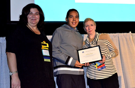 ITK President Natan Obed, standing with CASP 2016 co-chair Charlotte Borg, receive's CASP's president's award Oct. 27 from CASP president Renée Ouimet. (PHOTO BY JIM BELL)
