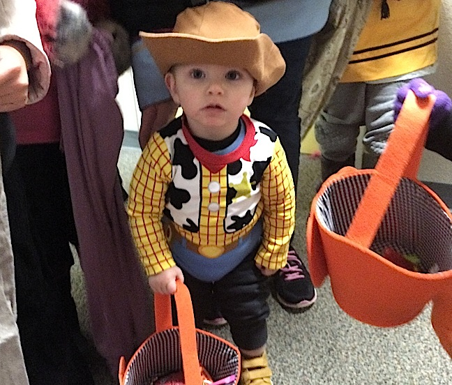 How could you refuse this little cowboy some candy? Avery Mercredi has a swell basket to fill trick-or-treating in Rankin Inlet on Oct. 31. Here's hoping Nunatsiaq News readers and their families had a safe and enjoyable Halloween. (PHOTO BY NOEL KALUDJAK)