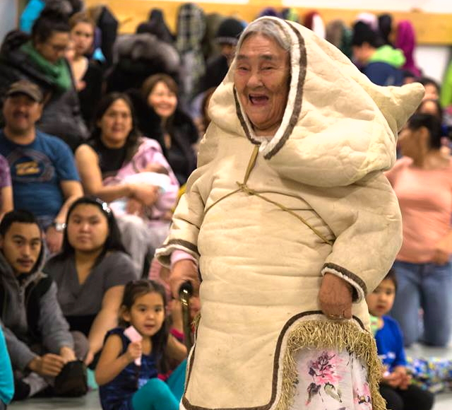 Arctic Bay elder Qaapik Attagutsiak struts her stuff in her homemade amauti during a traditional clothing fashion show in that north Baffin community Jan. 2. For more photos of the show, visit Niore Iqalukjuak's Facebook page. (PHOTO BY NIORE IQALUKJUAK)