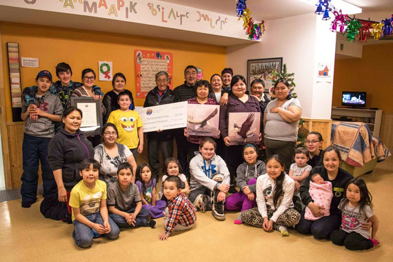Qarmaapik House staff and clients pose last week in Kangiqsualujjuaq with the group's $700,000 cheque from the Arctic Inspiration Prize. (PHOTO BY MARK BRAZEAU)