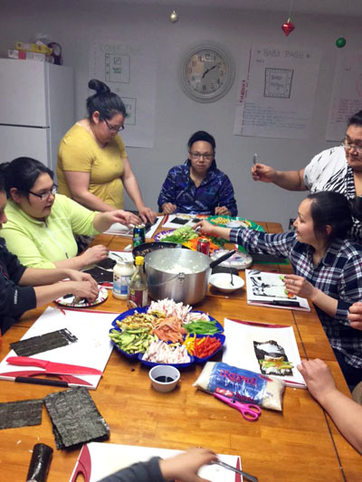 Qarmaapik House offers a twice weekly community kitchen workshop, which teaches community members to prepare healthy meals. Participants made sushi on night earlier this month. (PHOTO BY N. ETOK)