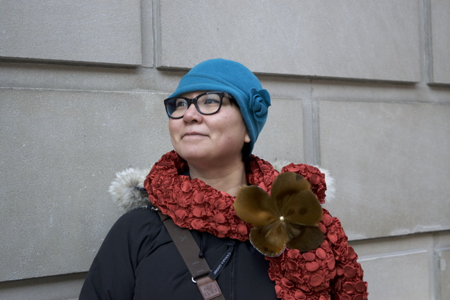 Oo Aqpik models a sealskin adorned scarf she made. Aqpik's works are part of the Studio Sixty Six gallery's