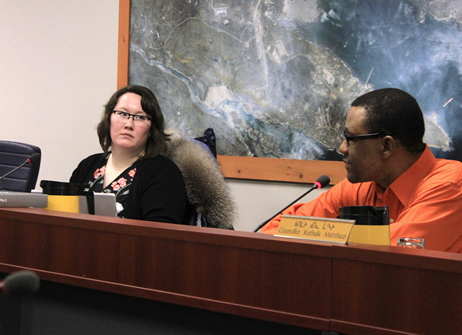 Megan Pizzo-Lyall with fellow councillor Kuthula Matshazi, at an Iqaluit city council meeting Jan. 10. Pizzo-Lyall announced at the meeting that she will be resigning from council to pursue a job outside of Iqaluit. (PHOTO BY LISA GREGOIRE)