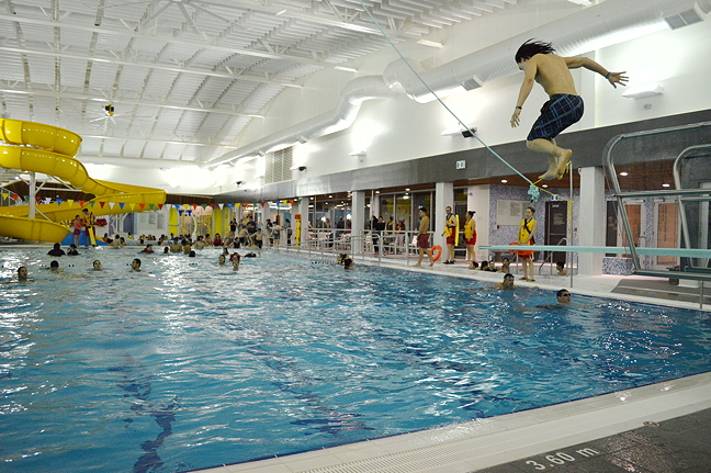 Last one in's a rotten egg... a man flies off the diving board into Iqaluit's new pool following the grand opening Jan. 26. (PHOTO BY STEVE DUCHARME)