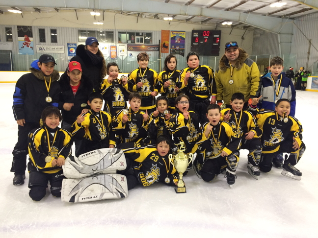 Members of the Rankin Rock hockey team show off the gold medals they won in a tournament Jan. 27 to Jan. 29 in Rankin Inlet. The Rock beat out Coral Harbour in the final and Arviat beat out Naujaat in a tight one-goal lead to take the bronze. Seven teams competed in the tournament including teams from Baker Lake, Naujaat, Arviat, Coral Harbour and three teams from Rankin Inlet. (PHOTO BY NOEL KALUDJAK)